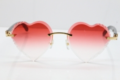 Cartier Rimless 3524012 Heart Black Buffalo Horn Sunglasses in Gold Red Lens